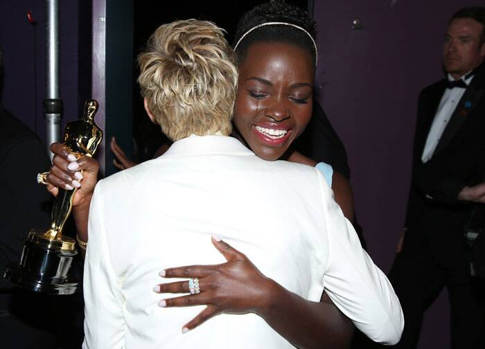 Lupita gets emotional as she hugs Ellen DeGeneres backstage after receiving the Best Supporting Actress for '12 years a Slave'.