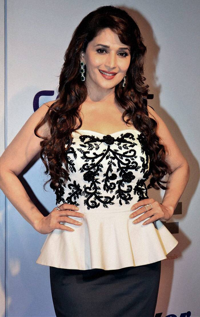 Dancing diva Madhuri Dixit wore a monochrome outfit - whie peplum top with black skirt. (PTI)