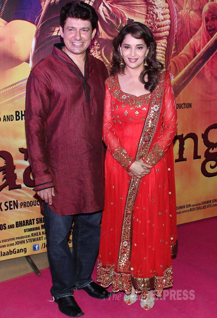 "Madhuri Dixit looked radiant in a bright red churridar suit as she posed along with her husband Dr. Sriram Nene. ""Good morning everyone. Delighted to see the audience's reaction at the screening yesterday! Thank you for all the love and support!,"" tweeted Madhuri. (Photo: Varinder Chawla)"