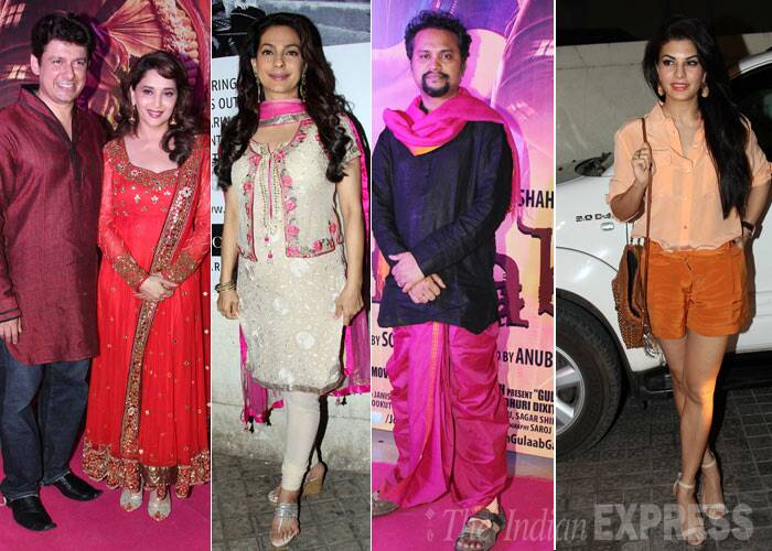A pink carpet was rolled out in Mumbai on Thursday (March 6) for the special screening of Madhuri Dixit and Juhi Chawla starrer 'Gulaab Gang'. Madhuri Dixit was seen with her husband Dr Sriram Nene and mother Snehala Dixit.<br /><br /> Her co-star Juhi Chawla was also dressed in pink and also seen at the screening was Jacqueline Fernandez. <br /><br /> In keeping with the film's theme, a few celebrities chose to wear the colour pink. (Photo: Varinder Chawla)
