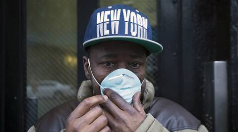 A pedestrian adjusts his mask after the gas explosion in New York. (AP)