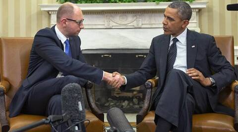 President Barack Obama, right, and Ukraine Prime Minister Arseniy Yatsenyuk, left, shake hands. (AP)