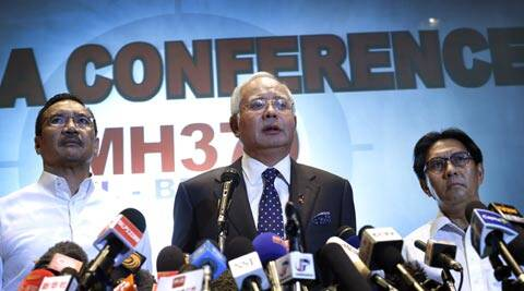 Malaysian Prime Minister Najib Razak, center, delivers a statement to the media regarding the missing Malaysia Airlines jetliner MH370. (AP)