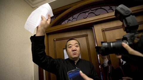 A Chinese relative of passengers aboard a missing Malaysia Airlines plane speaks to the media outside a holding room at a hotel in Beijing. (AP)