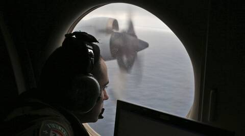 Flight officer Rayan Gharazeddine on board a Royal Australian Air Force AP-3C Orion, searches for the missing Malaysia Airlines Flight MH370 in southern Indian Ocean, Australia. (AP)