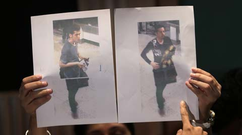 Pictures of the two men, a 19-year old Iranian, and the man on the right, his identity still not released. (AP)