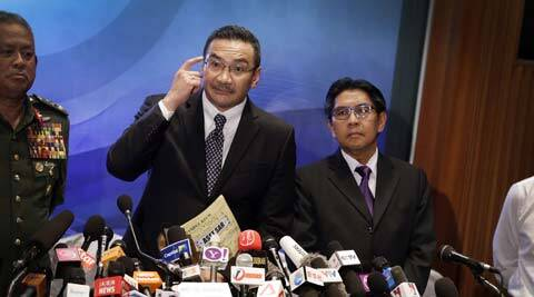 Malaysia's Minister of Transport Hishamuddin Hussein give a press conference about the missing Malaysia Airlines jetliner MH370. (AP)