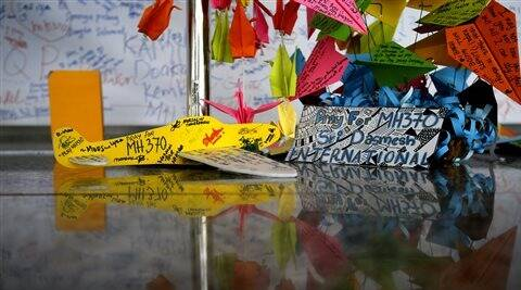 A foam plane with messages and other cards with personalized messages dedicated to people involved with the missing Malaysia Airlines jetliner MH370, is placed at the viewing gallery at Kuala Lumpur International Airport.