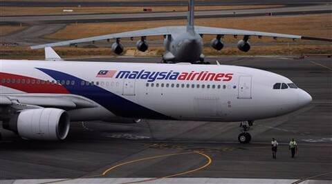 In this file photo, a Malaysia Airlines plane, foreground, prepares to go out onto the runway in Perth. (AP)
