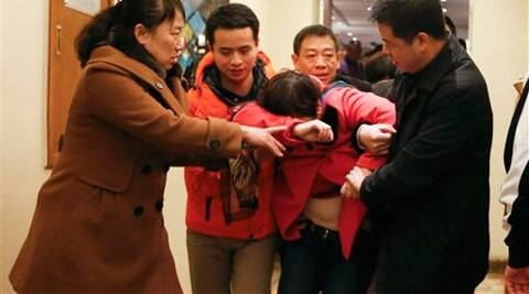 Inconsolable relatives of passengers aboard a missing Malaysia Airlines plane. (AP)