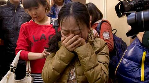 A Chinese relative of passengers aboard a missing Malaysia Airlines plane, cries in Beijing. (AP)