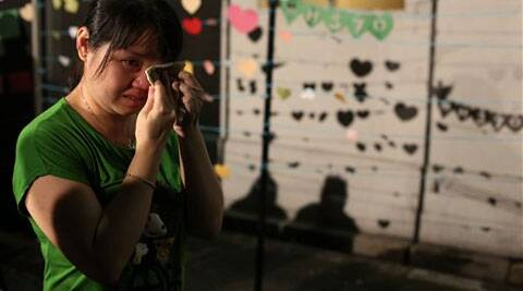 A woman breaks into tears during a ceremony for the passengers on board the missing Malaysia Airlines flight MH370 in Kuala Lumpur. (AP)