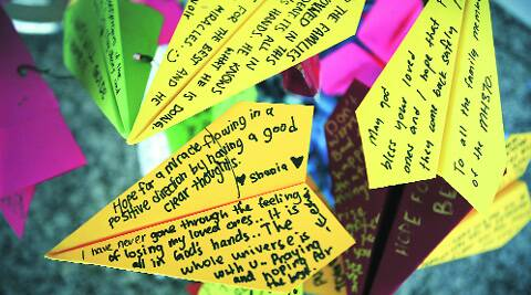 Messages for passengers of MH370 at the Kuala Lumpur airport Saturday. (AP)