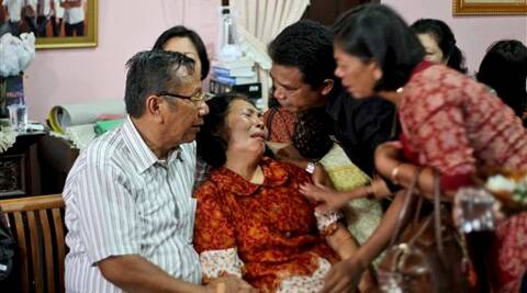 Family members comfort the parents of Firman Siregar, one of the Indonesian citizens onboard the Malaysia Airlines jetliner flight MH370 that went missing. (AP)