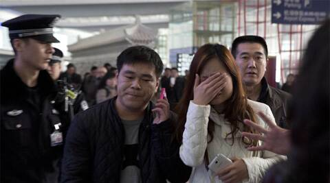Relatives and friends were arriving at Beijing airport for news after a Malaysia Airlines Boeing 777-200 was reported missing on a flight from Kuala Lumpur to Beijing Saturday. (AP)