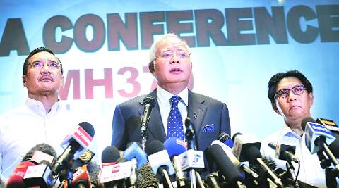 Malaysian Prime Minister Najib Razak (center) delivers a statement to the media regarding the missing Malaysia Airlines jetliner MH370. (AP)