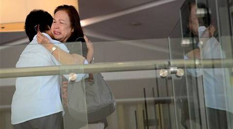 Family members of passengers aboard a missing plane cry at a hotel in Malaysia. (AP)