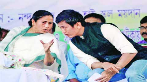 Mamata Banerjee with party's candidate for Darjeeling, Baichung Bhutia, at an election rally in Naxalbari near Siliguri on Tuesday. (PTI)