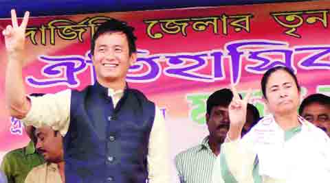 Chief Minister Mamata Banerjee with Baichung Bhutia during an election rally at Naxalbari Tuesday. (PTI)