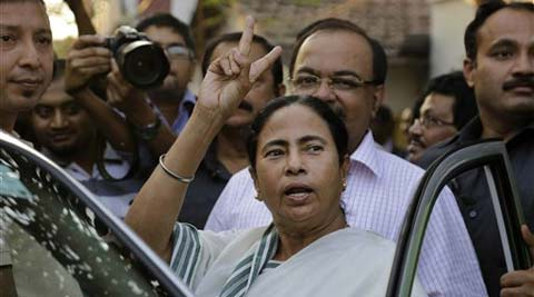 Trinamool Congress party chief and Chief Minister of West Bengal state Mamata Banerjee, flashes victory sign. (AP)