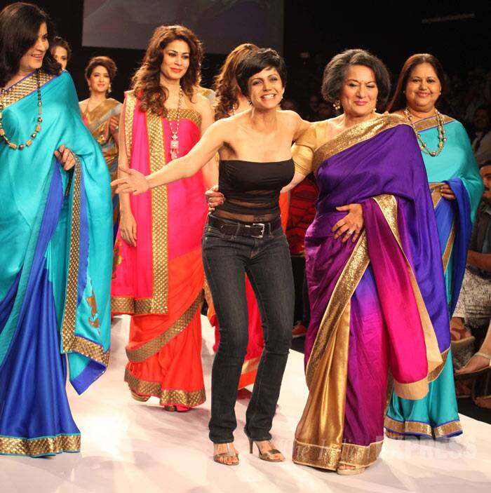 Women achievers from all walks of life including doctors, nutritionists and lawyers sashayed down the ramp for TV actress Mandira Bedi, who made her debut at the Lakme Fashion Week. <br /><br /> Making her maiden appearance at LFW 2014, Mandira, 41, showcased a beautiful feminine sari collection on the day two of fashion  extravaganza. Seen here with her mother Geeta Bedi on the ramp (IE Photo: Dilip Kagda)