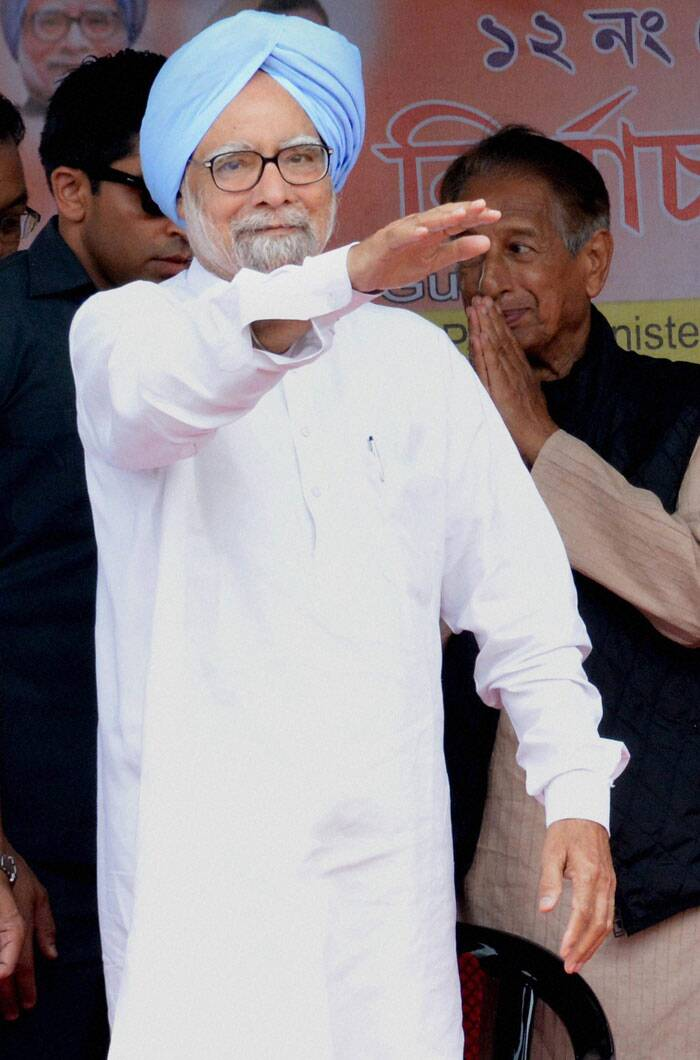 Prime Minister Manmohan Singh waves towards the crowd during an election rally at Khumtai, Sivasagar on Saturday. (PTI)