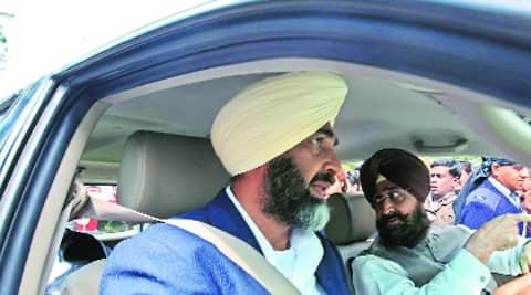 Manpreet Badal drives Punjab Congress president Partap Singh Bajwa in his SUV. Jaipal Singh