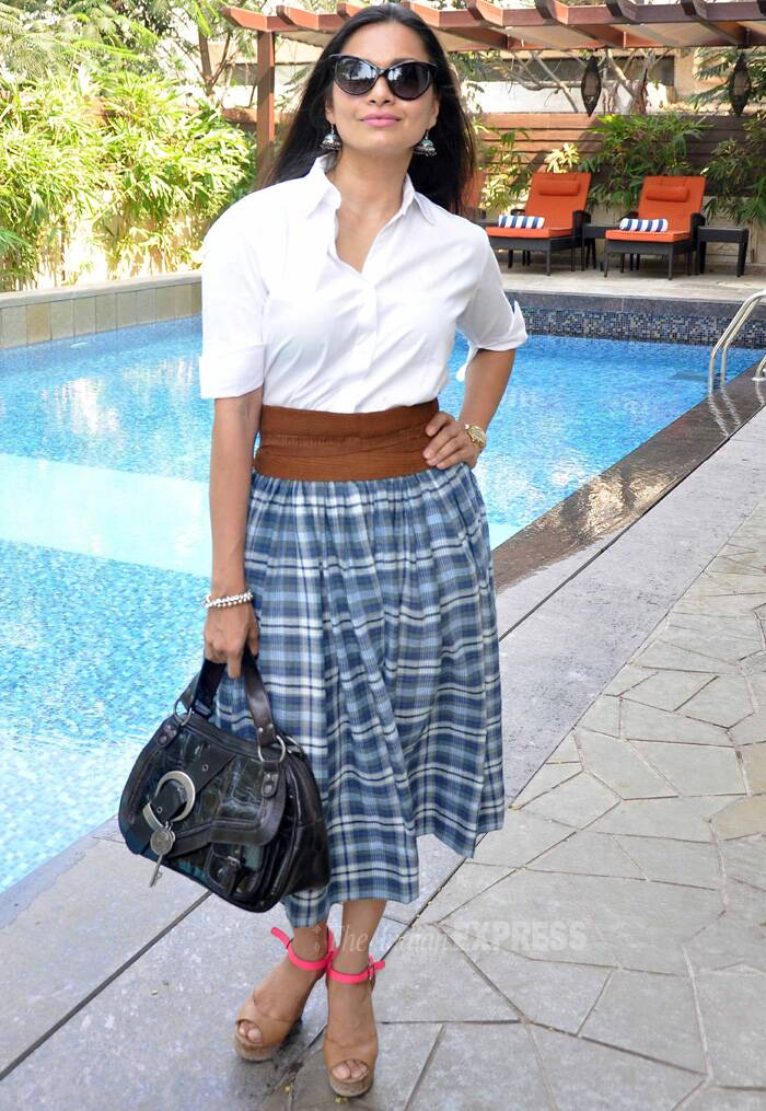 Arshad Warsi's wife and former VJ, Maria Goretti was sassy in a white shirt paired with a high-waist checked skirt and neon pink strapped wedges. (Photo: Varinder Chawla)