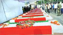 People pay tribute to the CRPF personnel killed in the Naxal attack, in Jagdalpur on Wednesday. 	PTI