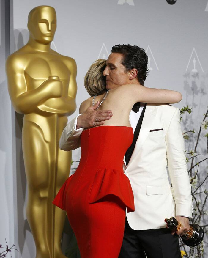 Jennifer Lawrence embraces Matthew McConaughey after the actor bagged the Best Actor Award for 'Dallas Buyers Club'.