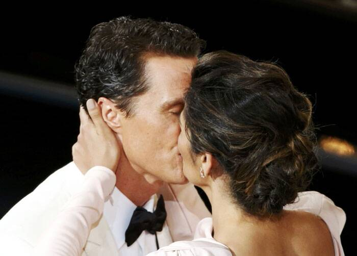 Best Actor this year, Matthew McConaughey shares a kiss with his wife Camila Alves.