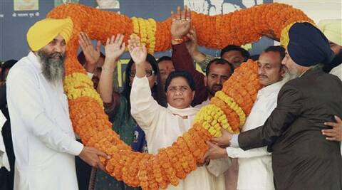 BSP national president Mayawati being garlanded by supporters during an election rally in Chandigarh on Sunday. (PTI)