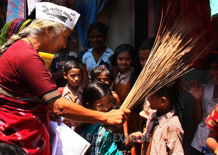 Medha Patkar spends playful time with kids in the area. (IE Photo: Amit Chakravarty)