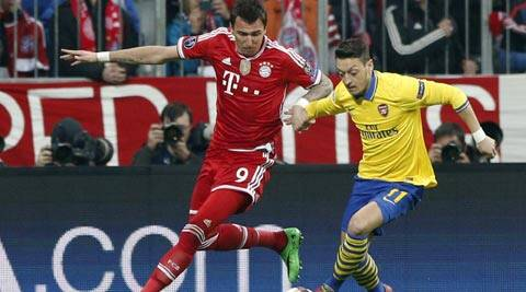 Mesut Ozil was substituted at halftime against Bayern Munich (AP)