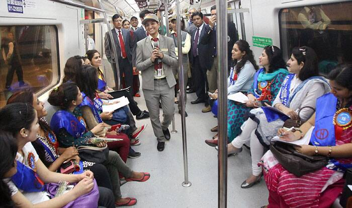 "A group of regular women Metro commuters enjoying a metro ride on the invitation of DMRC during the launch of its ""Know Your Metro"" campaign for commuters on the occasion International Women's Day in New Delhi on Saturday.(PTI)"