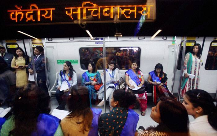 A group of regular women Metro commuters enjoying a metro ride in New Delhi. (PTI)