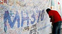 Malaysian PM Najib Razak says committed to finding Flight MH370
