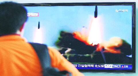 A man watches a news programme showing missiles launch conducted by N Korea, in Seoul, Wednesday.AP