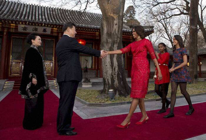 Like her mother Malia picked a red dress too, while Sasha was impeccable in her blue floral dress she teamed it with translucent black stockings and ballerinas. (Reuters)