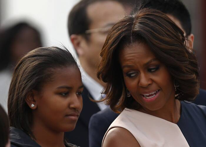 Michelle Obama talks to her daughter Sasha during her visit at the City Wall. (Reuters)