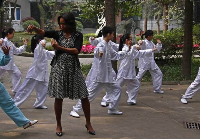 Michelle Obama practices Taichi with students at Chengdu No. 7 High School during her visit in Chengdu, Sichuan. (Reuters)