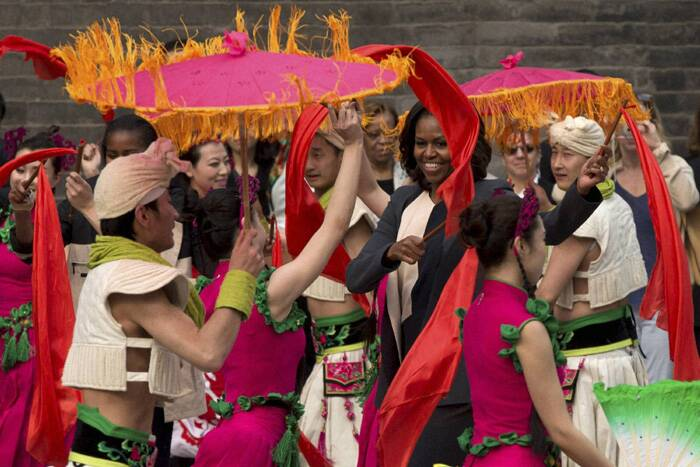 Michelle Obama dances with performers during her visit to an ancient city wall with her daughters and her mother in Xi'an, in northwestern China's Shaanxi province. (AP)