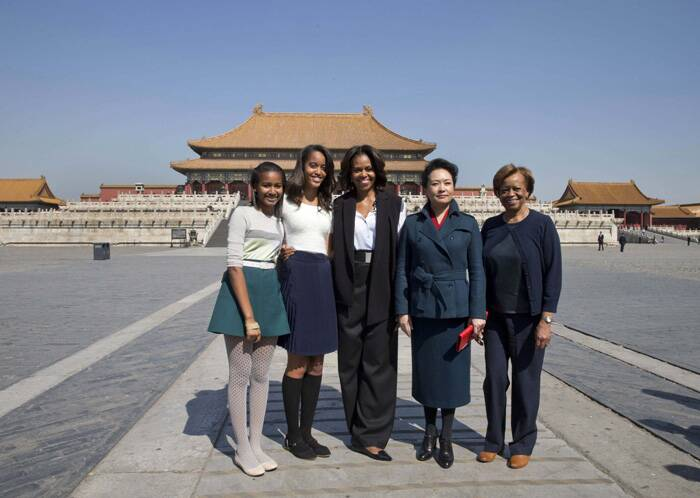 U.S. first lady Michelle Obama, who is on a week-long trip to promote education and cultural ties with China, along with her daughter Sasha and Malia visited the Forbbiden City in Beijing on Friday (March 21) along with China's first lady Peng Liyuan. (Reuters)
