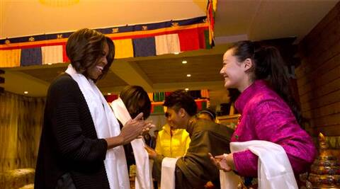 US first lady Michelle Obama is greeted by Tibetan students at a Tibetan restaurant in Chengdu in southwest China's Sichuan province Wednesday. (AP)