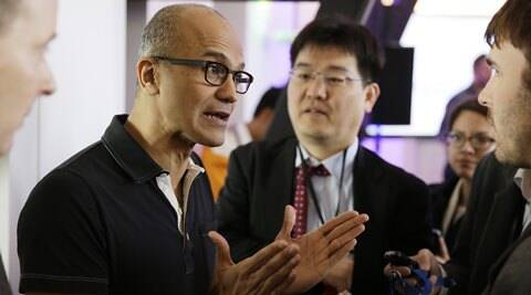 Microsoft CEO Satya Nadella gestures while speaking with reporters after giving a press briefing on the intersection of cloud and mobile computing. (AP)
