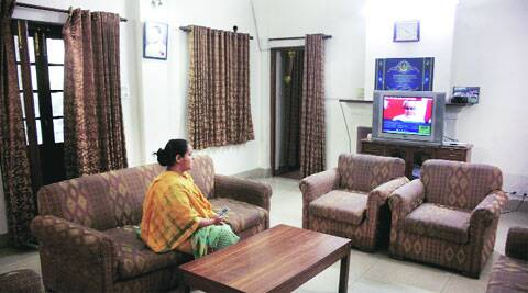 Alone at Ram Kripal Yadav's home in Delhi on Friday afternoon, Lalu Prasad's daughter Misa watches television — which, ironically, is showing pictures of her father's arch rival Nitish Kumar.  (Photo: Anil Sharma)