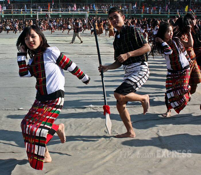 Mizo youth perform the 'Pawhlohtlawh' during the annual traditional Chapchar Kut in Mizoram. (IE Photo: Adam Halliday)