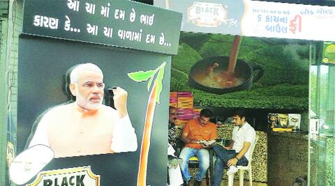 BJP leaders discuss preparations for Chai pe Charcha at a retail shop in Rajkot on Wednesday. Express