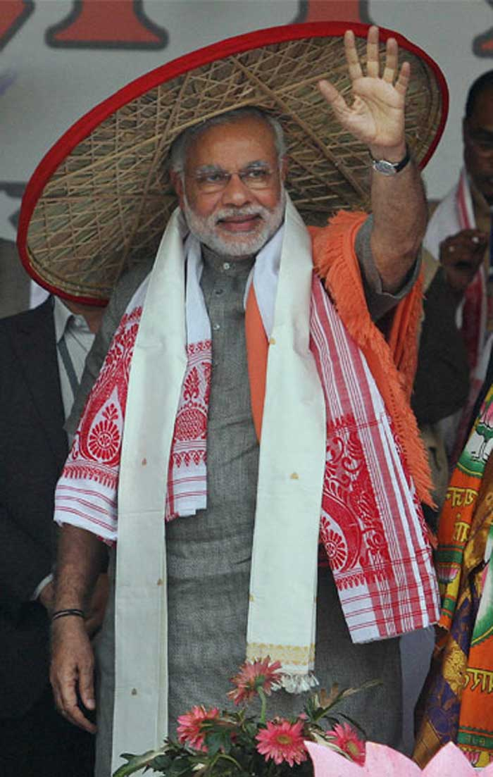 Narendra Modi wearing Assamese japi during the Mahajagaran Rally in Guwahati. (PTI Photo)