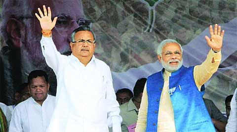 Modi with Chief Minister Raman Singh in Chhattisgarh, Friday. (PTI)